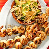 Grilled Drunken Shrimp and Scallop Skewers Recipe - Kick up the flavor of regular grilled shrimp and scallops with a bold garlic, lime, and tequila marinade. A cool jicama, avocado, and cilantro slaw is the perfect complement to this healthy summer dinner.