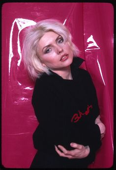 Portrait of American singer Debbie Harry from the band Blondie as she poses against a pink vinyl backdrop New York New York 1970s
