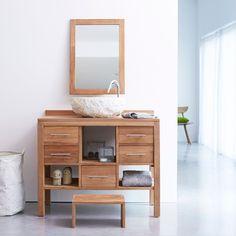 Découvrez ce meuble de salle de bain en teck brut de la marque Tikamoon.Apportez une touche de modernité et de style avec ce meuble au design contemporain. Sa teinte naturelle lui confère un aspect naturel et authentique.Grâce à ses nombreux espaces de rangement vous pourrez disposer tous vos produits de beauté ainsi que votre linge de maison. Il dispose de 3 niches ouvertes et 5 tiroirs.Il convient très bien pour une famille avec des enfants en bas âge grâce à son marche…
