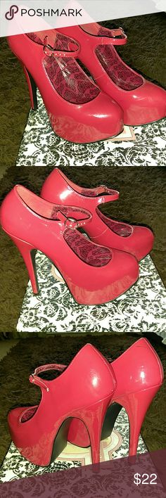 RED HOT PLATFORM PUMPS WORN TWICE!! GREAT CONDITION!! NARROW! 5 1/2 inch platform pumps with gold buckled strap across the front ankle. As tall as they are, the have great support. CAN'T GO WRONG WITH SEXY RED PUMPS!! *Original box included Bordello Shoes Platforms