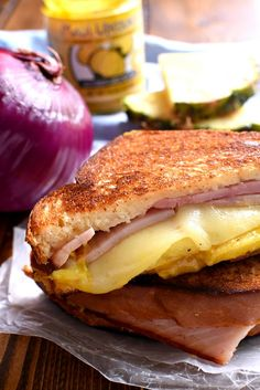 This Hawaiian Ham & Cheese Sandwich is loaded with pineapple, red onion, ham, cheese, and the BEST Onion & Garlic Mustard! It's the perfect blend of savory and sweet, and a delicious twist on basic ham & cheese.
