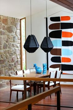 A Marimekko Pikku Jätski wall hanging adds bold colors and shapes to your dining experience.