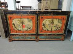 Antique Chinese Storage Credenza with Painted Red Doors and Chinese Motif - Via Etsy.