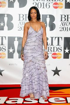 Rihanna wearing  Armani Privé Couture Gown