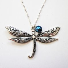 Hey, I found this really awesome Etsy listing at http://www.etsy.com/listing/113218182/silver-dragonfly-necklace-dragonfly