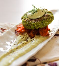 Shiitake Green Garbanzo Patties Served Over Roasted Carrots With Herb Aioli