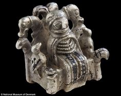 Worship: A talismanic figure of Odin, king of the gods, accompanied by his two ravens Hugi...