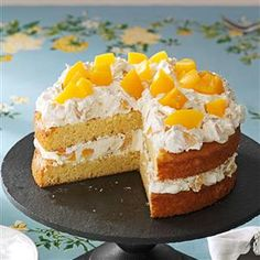 Cake with Peaches Recipe -This springtime layer cake is peachy and creamy. My mom gets requests for this cake from my brother for his April birthday. —Tamra Duncan, Decatur, Arkansas