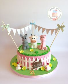 Girly farm animals birthday cake with edible cow, donkey, pig and chickens figures