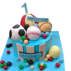 Cake With Blue Icing Topped Baseball Football Tennis Ball Made Of Fondant And Lined Strips Order Now Get Birthday Delivery In