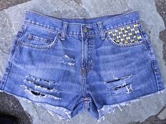 Upcycled jeans shorts by 16-year old designer Sophia Scanlan for Stubborn Jeans. Ripped with checkerboard pocket studs.