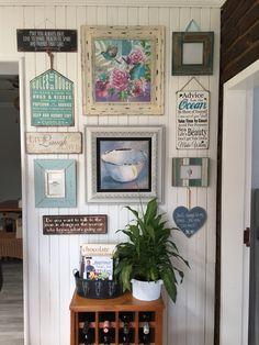 Country looking kitchen gallery wall.