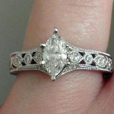 Marquis style engagement rings are growing on me...they're unique. I mean every one has a round diamond these days. It sort of reminds me of the 20's.