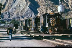 RailPictures.Net Photo: Here's a picture of railroading, not just trains!  In Helper, Utah, crews cut in a bevy of four-axle EMD units to assist a coal train up the 2.4% grades of Price River Canyon.  James Belmont took this photograph in September, 1976.