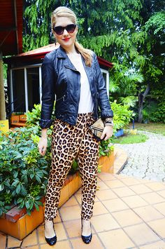 Pair leopard pants with a basic white t-shirt and a fierce motorcycle jacket !