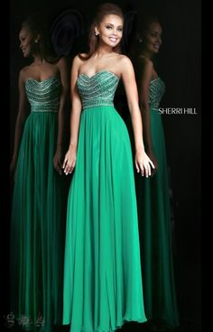 Elegance. Classy. Sophisticated. Glamorous. Four words that describe Sherri Hill 8546 to the t! This gown has a strapless sweetheart neckline and an empire waist band that will really show off a delicate hourglass figure. The silky chiffon skirt falls flawlessly to the floor. Which looks great coming or going! The detailed bead work goes to show you just how lovely this dress is! Created for proms and pageants, this dress is timeless piece!