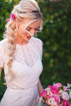 Bridal braid studded with bougainvillea | Photo by LKM Studios
