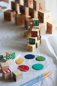 Fun baby shower activity - painted alphabet blocks.