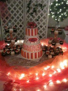 fuschia and orange wedding cake with black accents