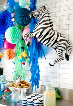 We are absolutely in love with this colourful party by Cake Ink to celebrate her son's second birthday. From the amazing backdrop to the stunning confetti cake, there are too many wonderful details...