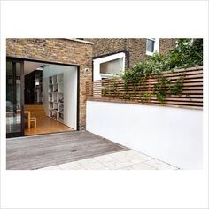 VENETIAN FENCE. I love the white stucco wall with wood fence! This is how I'll do the backyard entry wall.