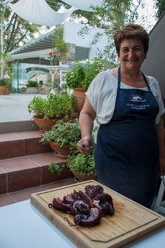 Katerina and her cooked octopus Odyssey Poros Greece