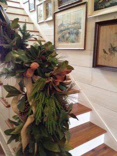 staircase garland for Christmas Southern Living idea house Happy Friday y'all! We traveled back to the idea house in Senoia, Georgia last weekend to decorate the 2012 Southern Living Idea House for Christmas. The house is now open for tours every wed… Christmas Stairs, Christmas Mantels, Rustic Christmas, Winter Christmas, Christmas Home, Christmas Wreaths, Merry Christmas, Christmas Greenery, Natural Christmas