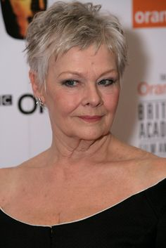 Judi Dench Lookbook: Judi Dench wearing Evening Dress (6 of 6). Judi Dench showed off her collarbones with a shoulder baring black dress at the Orange British Academy Film Awards.