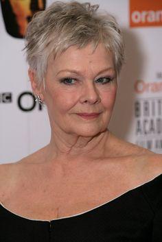 Judi Dench Lookbook: Judi Dench wearing Evening Dress (6 of 6). Judi Dench showed off her collarbones with a shoulder baring black dress at the Orange British Academy Film Awards.