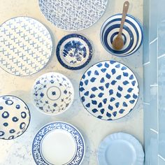 Mis matched blue and white dinnerware.