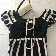 DRESS BLACK N WHITE Black n white pop dot bold design on this cute dress gathers at waist stretch and bubble sleeve short sleeve dress is 29 inches long at knee length very cute on Trend TIANA B  Dresses Mini