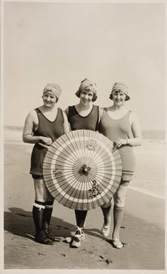 Ca 1920 (i cannot imagine how much it would suck to wear knee-high socks to the beach lol)