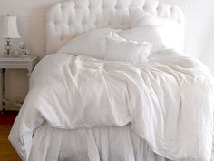 ethereal spring whites {love the tufted headboard and the white on white bedding}