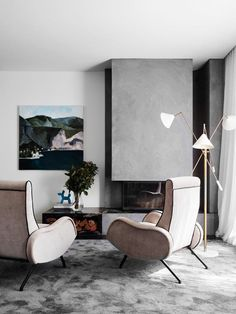 A modernist grey living room with a fireplace. #modernist #fireplace #modernhome #livingroom #livingarea #fireplacedesign Stone Fireplace Surround, Fireplace Design, Fireplace Ideas, Flack Studio, Melbourne Architecture, Daybed Design, Polished Plaster, Niche Design, Metal Side Table