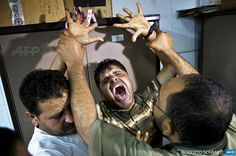 AFP Photo Department on Twitter: The father of one of three children killed reacts at #Gaza city's Al-Shifa hospital by @robertoindelhi #AFP http://t.co/CczA5oOAys