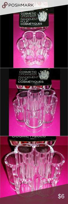 "Flower Cosmetics Organizer NEW Beauty Storage Flower Shaped Acrylic Cosmetic Organizer ~ New In Box  This fun & functional clear acrylic organizer is great for storing your brushes, lipsticks, mascara, eye liners and much more!   Measures 3.5"" Wide & 2.3"" Tall. The outside ring of ""petals"" consists of 6 larger slots (1.1"") and the inside of the flower has 6 small slots (.04"").  Back is slightly higher than the front so that you can see all products inside easily.  Product is new in box…"