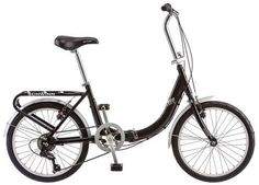 Schwinn Loop Folding Bike, Black 20 - inch folding bicycle designed for commuting Low stand over frame and rigid fork for easy on and off Sure stopping alloy linear pull brakes 7 speed drivetrain to get up hills easily Nylon carrying bag included Small Airplanes, 20 Inch Wheels, Folding Bicycle, Commuter Bike, Bicycle Maintenance, Cool Bike Accessories, Bike Reviews, Kids Bike, Bike Rack