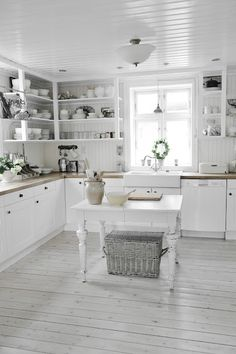 White farmhouse kitchen. It has everything I love: open shelving, bead board, and butcher block counter tops.