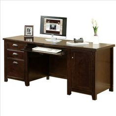 kathy ireland Home by Martin Tribeca Loft Cherry Computer Credenza - Fully Assembled. Hand applied Burnt Umber Cherry finish on hardwood solids and veneers. CPU space measures 14w x 20.75h with a Power Communication Center and adjustable shelf. Convertible keyboard/pencil drawer and two utility drawers (one with dividers) for easy storage. One locking file drawer for document organization and security. Semi-finished back, unit is meant to be placed against a wall. Superior drawer...