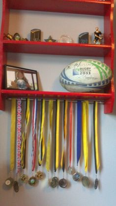 A curtain rod perfect for hanging medals. Such a smart idea! Trophy Shelf, Trophy Display, Soccer Bedroom, Girls Bedroom, Bedroom Ideas, Hanging Medals, Boy Room, Kids Room, Craft Room Storage