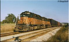Two Milwaukee Road SD40-2s, #134 and #154, lead a westbound freight through Oakdale, Wisconsin on September 18, 1982.