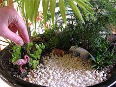 Pink flamingos and a monkey take over a miniature garden. #GardeninginMiniature