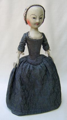 """William and Mary Period English Wooden. 15"""" tall and identical in every way to the antique dolls of the period dating from the 1680's. Rare dress fabric dates the 16th century."""