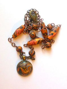 Bronze colour polymer clay necklace.