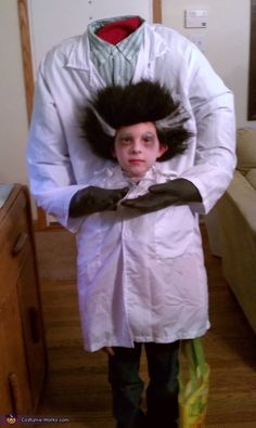 This mad scientist who lost his head. | 23 Kids Who Are Totally Nailing This Halloween Thing