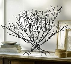 This could be made out of wood sticks as a base for paper mache clay to make a large coral.