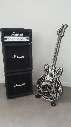Paul Tinson - Brisbane Artist specialising in welded metal guitar sculptures and DEADHEADS constructed from discarded material of a mechanical nature. Metal Art Projects, Welding Projects, Metal Crafts, Metal Tree Wall Art, Scrap Metal Art, Diesel Punk, Sculpture Metal, Unique Guitars, Metal Garden Art