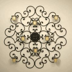 View our large selection of iron wall decor, oversized wall grilles, iron wall mirrors, wrought iron wall art and metal framed artwork in ou. Candle Wall Decor, Candle Wall Sconces, Wrought Iron Wall Decor, Metal Wall Decor, Rod Iron Decor, Iron Wall Art, Wrought Iron Candle Holders, Iron Furniture, Furniture Design