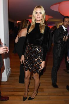 Heidi Klum's look was all about her short metallic skirt.
