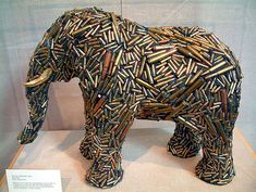 Elephant sculpture at the Detroit Zoo made up of Bullets and Gold Leaf. Bullet Art, Bullet Shell, Elephant Art, African Elephant, Sculpture Metal, Lion Sculpture, Elephant Sculpture, Detroit Zoo, Ancient Symbols